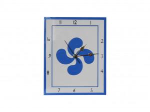 Pendule en faïence avec une croix basque bleue